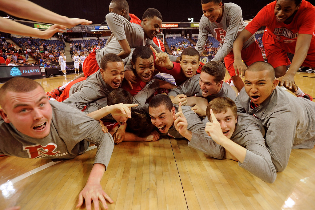 . Redondo Union High School players celebrate their victory over College Park High School during the Division II 2013 CIF State Basketball Championships at Sleep Train Arena, in Sacramento, Ca March 23, 2013.  Redondo won the game 54-47.(Andy Holzman/Los Angeles Daily News)