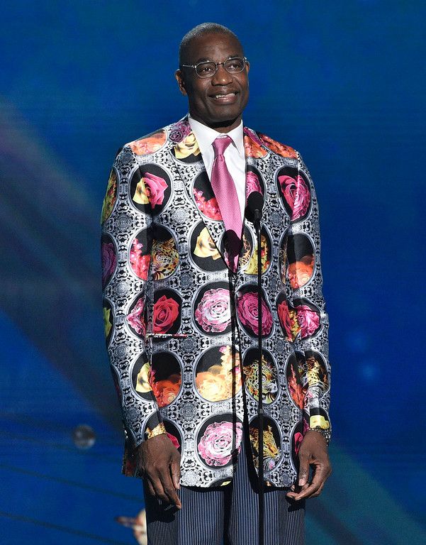 . Dikembe Mutombo puts on his Sager Strong award sport coat at the NBA Awards on Monday, June 25, 2018, at the Barker Hangar in Santa Monica, Calif. (Photo by Chris Pizzello/Invision/AP)