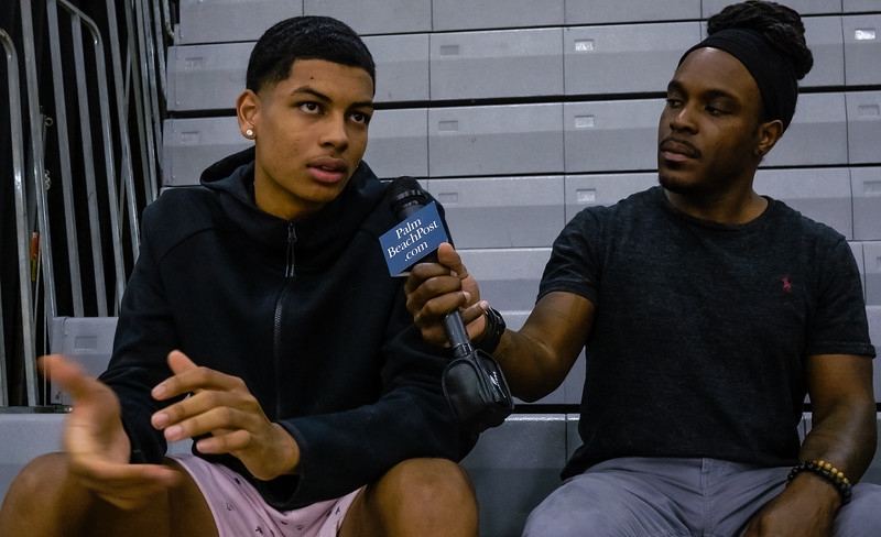 Myles Samules, a guard on Wellington High School's boys basketball team talks to Palm Beach Post reporter Wilkine Brutus about the new Nike Fear of God 1 Light Bone sneakers, donated to the Wellington High School boys and girls basketball teams by  fashion designer Jerry Lorenzo on Wednesday, January 16, 2019 at Wellington High School, in Wellington, Florida. Lorenzo, founder of streetwear label Fear of God, donated the sneakers to the Wellington High School boys and girls basketball teams. Each pair costs $350.00. [JOSEPH FORZANO/palmbeachpost.com]
