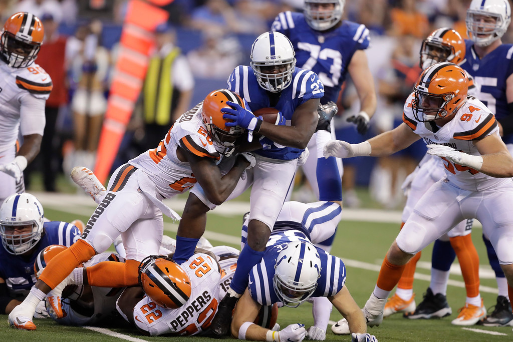. Indianapolis Colts running back Frank Gore (23) is tacked by Cleveland Browns strong safety Derrick Kindred (26) during the first half of an NFL football game in Indianapolis, Sunday, Sept. 24, 2017. (AP Photo/Darron Cummings)