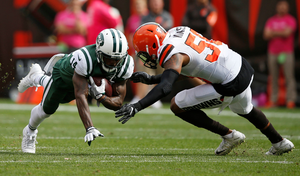 . New York Jets wide receiver Jeremy Kerley (14) is tackled by Cleveland Browns inside linebacker Christian Kirksey (58) after a pass reception during the first half of an NFL football game, Sunday, Oct. 8, 2017, in Cleveland. (AP Photo/Ron Schwane)