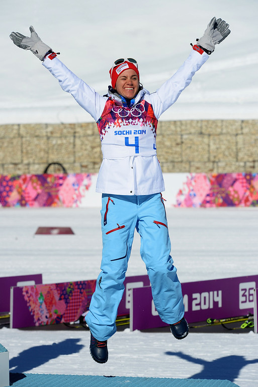 . Bronze medalist Heidi Weng of Norway celebrates on the podium during the flower ceremony for the Ladies\' Skiathlon 7.5 km Classic + 7.5 km Free during day one of the Sochi 2014 Winter Olympics at Laura Cross-country Ski & Biathlon Center on February 8, 2014 in Sochi, Russia.  (Photo by Harry How/Getty Images)