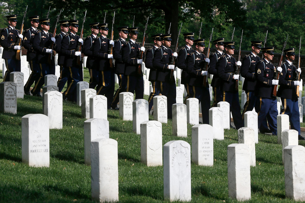 . A U.S. Army honor guard arrives at the gravesite of Army Pvt. William Christman, who was the first military burial at the cemetery, marking the beginning of commemorations of the 150th anniversary of Arlington National Cemetery in Arlington, Va., Tuesday, May 13, 2014. (AP Photo)