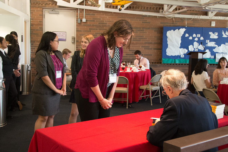 """Mariel Friberg (2013 Scholar)  with John Mather, as he signs copies of his book """"The Very First Light"""" -- An award luncheon, """"Dr. John Mather Nobel Scholars Program Award"""", as part of the National Space Grant Foundation. College Park Aviation Museum, College Park, MD, August 2, 2019."""