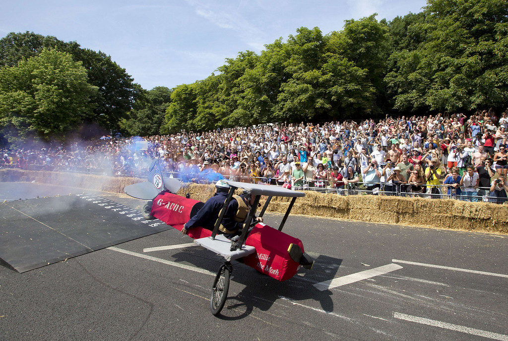 . Spectators watch a team competes in the Red Bull Soapbox race in London on July 14, 2013. The Red Bull Soapbox race is an annual event where amateur drivers race with their homemade soapbox vehicles down a 420m hill through obstacles.   JUSTIN TALLIS/AFP/Getty Images