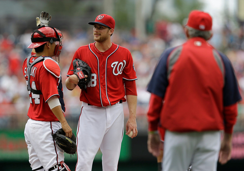 . Washington Nationals starting pitcher Ross Detwiler (48) stands on the mound with Washington Nationals catcher Kurt Suzuki (24) as manager Davey Johnson walks out to pull him in the fourth inning of a baseball game against the Colorado Rockies at Nationals Park, Sunday, June 23, 2013, in Washington. (AP Photo/Carolyn Kaster)