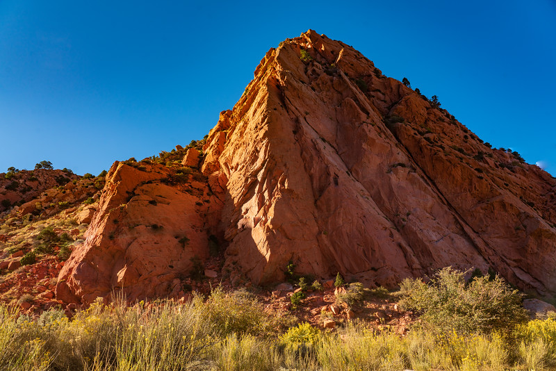 The Setting Sun Shines on Red Mountain
