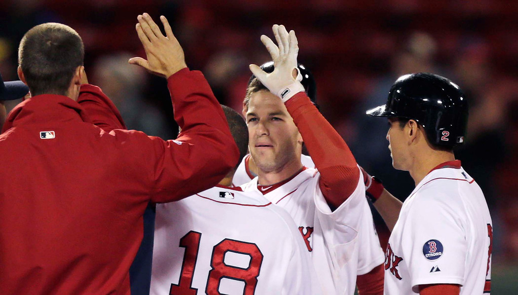 . Boston Red Sox shortstop Stephen Drew is congratulated by teammates after his game-winning, RBI double in the 11th inning. (AP Photo/Charles Krupa)