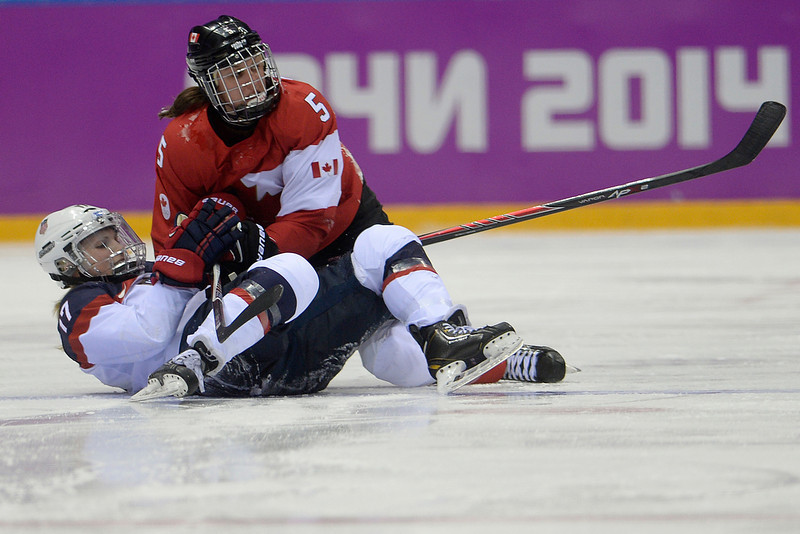 . Lauriane Rougeau (5) of the Canada checks Jocelyne Lamoureaux (17) of the U.S.A. during the third period of the women\'s gold medal ice hockey game. Sochi 2014 Winter Olympics on Thursday, February 20, 2014 at Bolshoy Ice Arena. (Photo by AAron Ontiveroz/ The Denver Post)