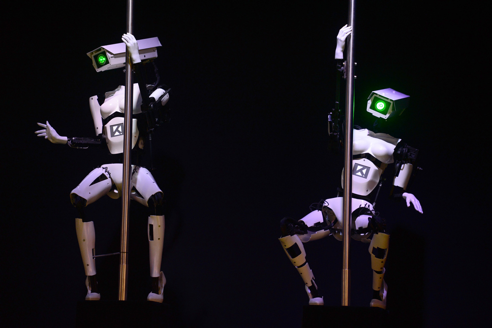 . Robots perform a pole dance at the booth of the Tobit Software company on the eve of the start of the 2014 CeBIT technology trade fair on March 9, 2014 in Hanover, central Germany. CeBIT will be pen March 10-14, 2014. JOHN MACDOUGALL/AFP/Getty Images