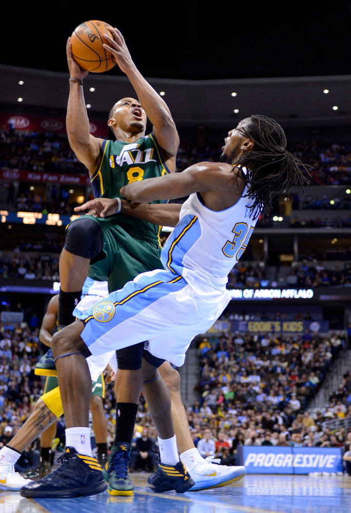 . Utah Jazz guard Randy Foye (8) is fouled by Denver Nuggets forward Kenneth Faried (35) during the third quarter of an NBA basketball game on Saturday, Jan. 5, 2013, in Denver. (AP Photo/Jack Dempsey)