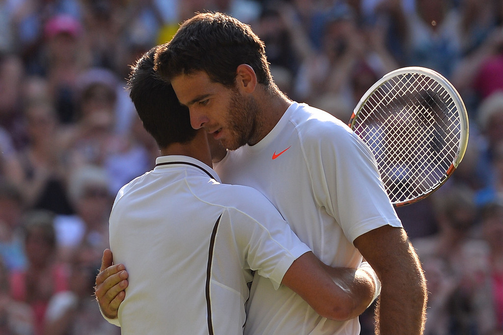 . Serbia\'s Novak Djokovic (L) embraces Argentina\'s Juan Martin Del Potro (R) after Djokovic\'s victory in their men\'s singles semi-final match on day eleven of the 2013 Wimbledon Championships tennis tournament at the All England Club in Wimbledon, southwest London, on July 5, 2013. Djokovic won 7-5, 4-6, 7-6, 6-7, 6-3. CARL COURT/AFP/Getty Images