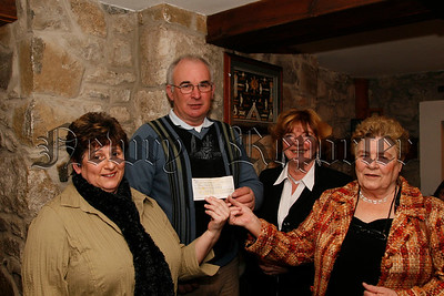 A fishing competition organised by Kilbroney Angling Club  in the memory of the late Fergal Collins in aid of Muscler Dystrophy which raised £340.00, Members of Fergals family present the Cheque to Michael Grant, Ann Mc Nally (sister) Isa Collins (mother) and Finoula Marriott(cousin), 07W6N65