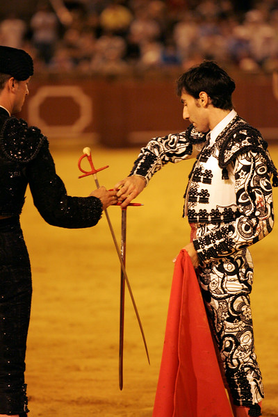 Fernando Cruz changing the fake (used for performing with the cape) for the real sword (used to kill the bull). Bullfight at Real Maestranza bullring, Seville, Spain, 15 August 2006.