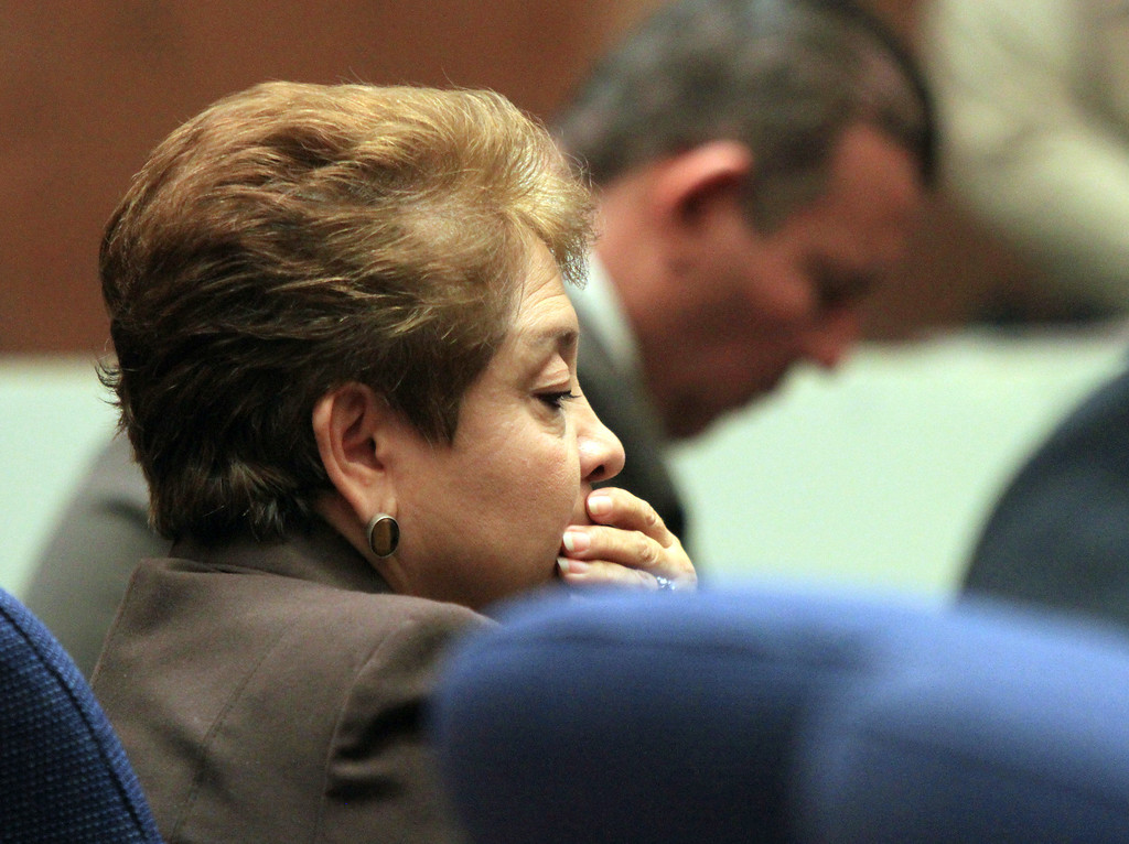 . Teresa Jacobo, a former Bell City elected official listens to the judge as a guilty verdict is read in her trial on Wednesday, March 20, 2013, in Los Angeles.  Jacobo and four former elected officials were convicted of multiple counts of misappropriation of public funds, and a sixth defendant was cleared entirely. Former Mayor Oscar Hernandez and co-defendants Jacobo, George Mirabal, George Cole, and Victor Belo were all convicted of multiple counts and acquitted of others.  The charges against them involved paying themselves inflated salaries of up to $100,000 a year in the city of 36,000 people, where one in four residents live below the poverty line.   (AP Photo/Los Angeles Times, Irfan Khan, Pool)