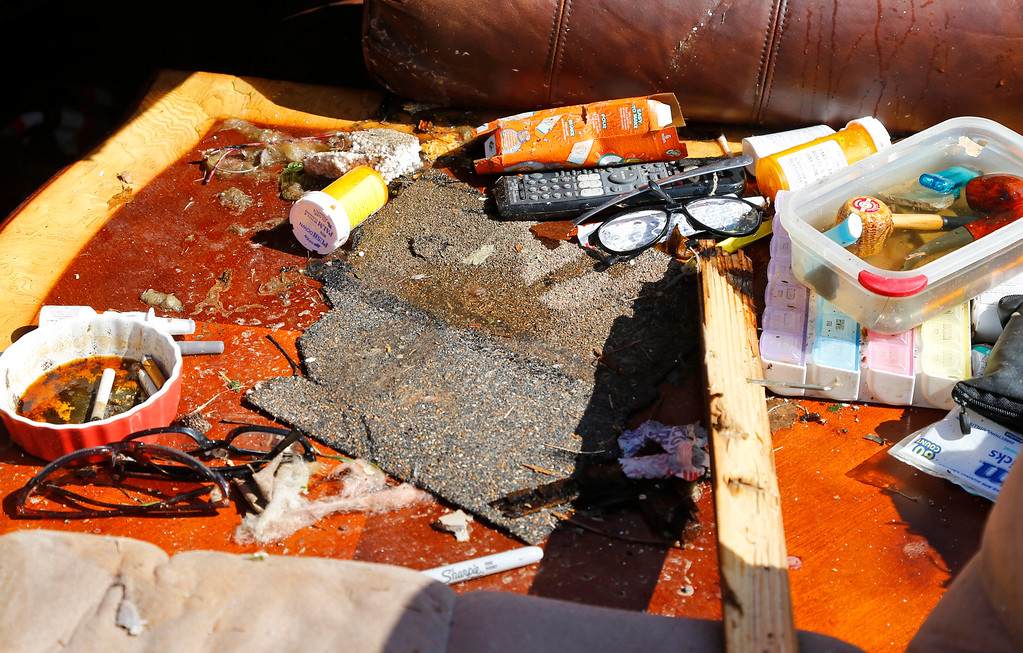 . Rain-soaked items are pictured on a table in a tornado-damaged mobile home in Sand Springs, Okla., Thursday, March 26, 2015. (AP Photo/Sue Ogrocki)