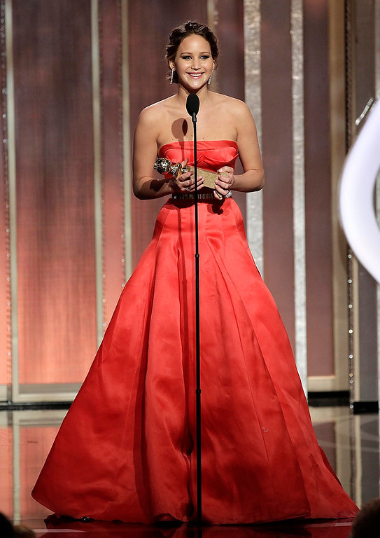 ". This image released by NBC shows actress Jennifer Lawrence with her award for best actress in a motion picture comedy or musical for her role in ""Silver Linings Playbook\"" during the 70th Annual Golden Globe Awards at the Beverly Hilton Hotel on Jan. 13, 2013, in Beverly Hills, Calif. (AP Photo/NBC, Paul Drinkwater)"