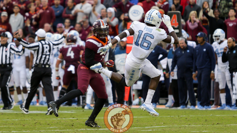 Hokies DB Reggie Floyd knocks down UNC's DJ Ford after a play, earning a personal foul call. (Mark Umansky/TheKeyPlay.com)