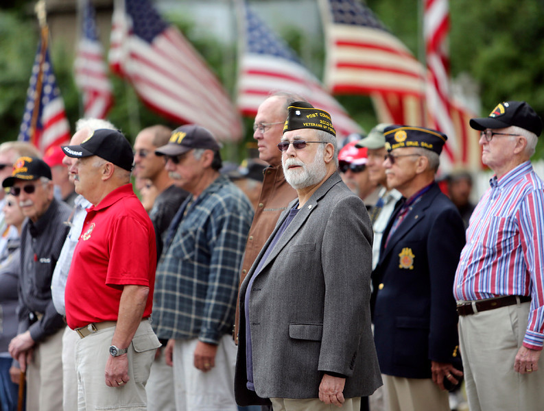 . Dozens of Veterans stand at attention during the annual Memorial Day remembrance service at Evergreen Cemetery in Santa Cruz on Monday. (Kevin Johnson/Sentinel)