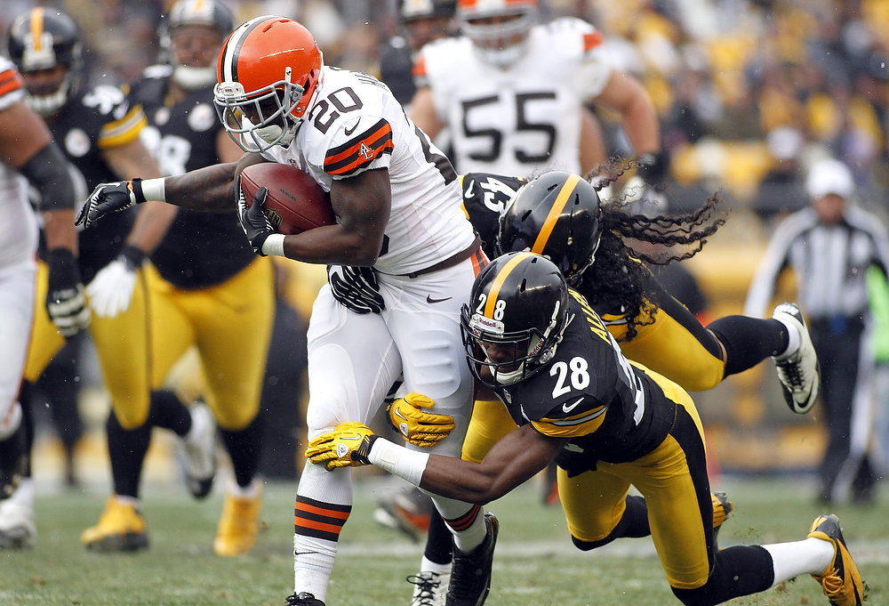 Description of . Montario Hardesty #20 of the Cleveland Browns carries the ball against Troy Polamalu #43 and Cortez Allen #28 of the Pittsburgh Steelers during the game on December 30, 2012 at Heinz Field in Pittsburgh, Pennsylvania.  (Photo by Justin K. Aller/Getty Images)