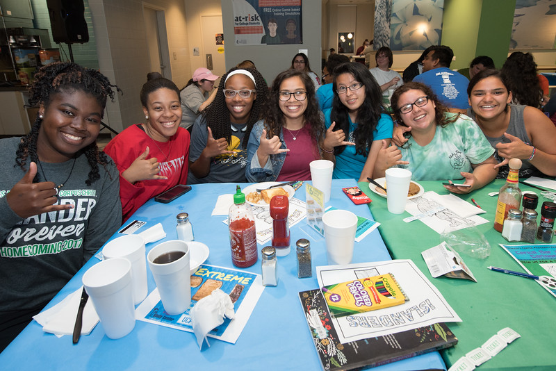 Students gather for a group photo during Late Night Breakfast in the Islander Dining Hall.