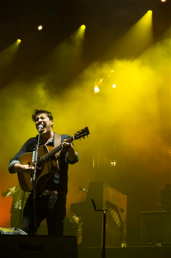 Description of . Mumford & Sons band member Marcus Mumford performs on Wednesday, Aug. 28, 2013 at the West Side Tennis Club in the Forest Hills neighborhood of the Queens borough of New York. (Photo by Charles Sykes/Invision/AP)