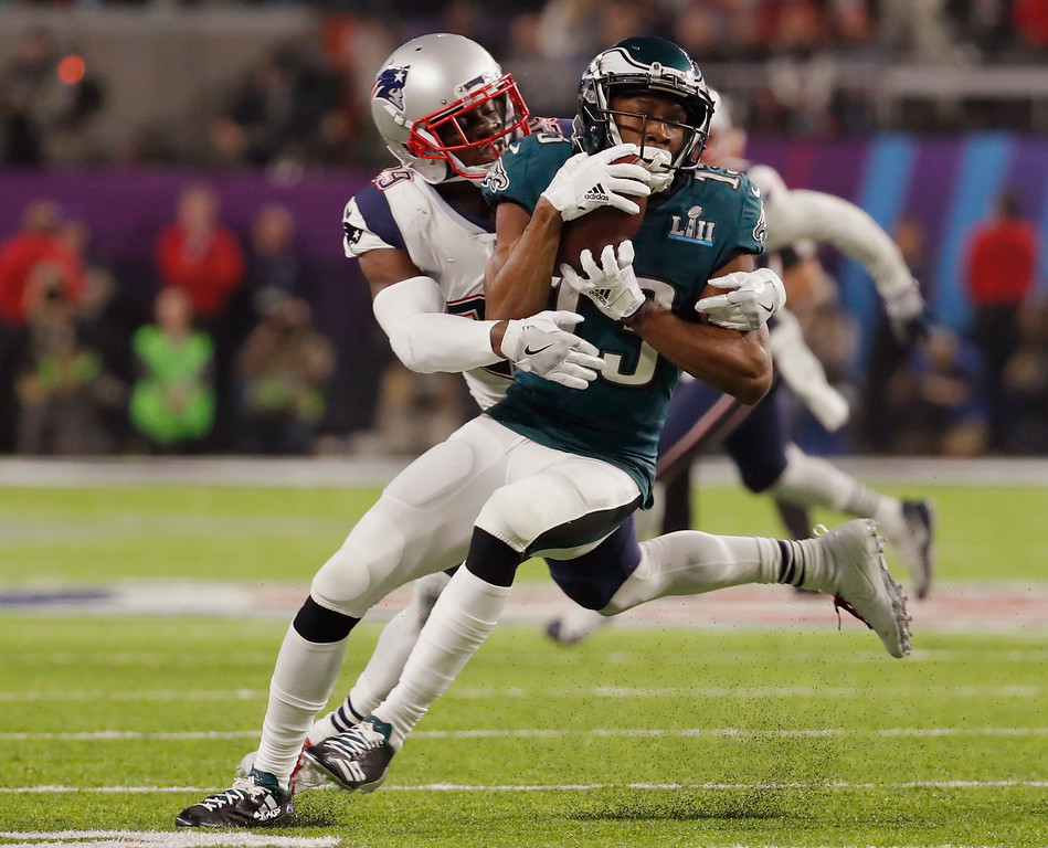 . New England Patriots cornerback Johnson Bademosi (29) tackles Philadelphia Eagles wide receiver Nelson Agholor (13), during the second half of the NFL Super Bowl 52 football game, Sunday, Feb. 4, 2018, in Minneapolis. (AP Photo/Charlie Neibergall)