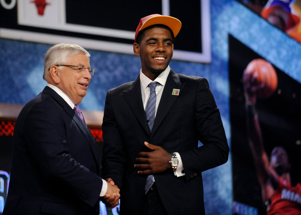 . NBA Commissioner David Stern, left, poses with the No. 1 overall draft pick, Kyrie Irving, of Duke, who was selected by the Cleveland Cavaliers in the NBA basketball draft   Thursday, June, 23, 2011, in Newark, N.J. (AP Photo/Bill Kostroun)