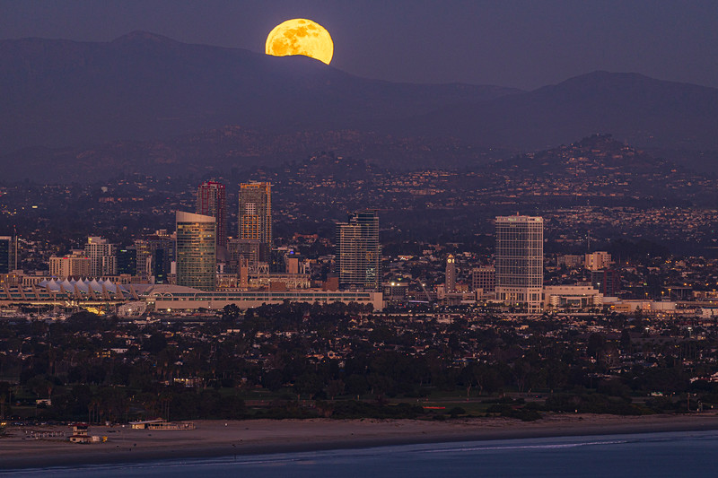 Full Moon Rises Over Downtown And The Mountains East Of San Diego.