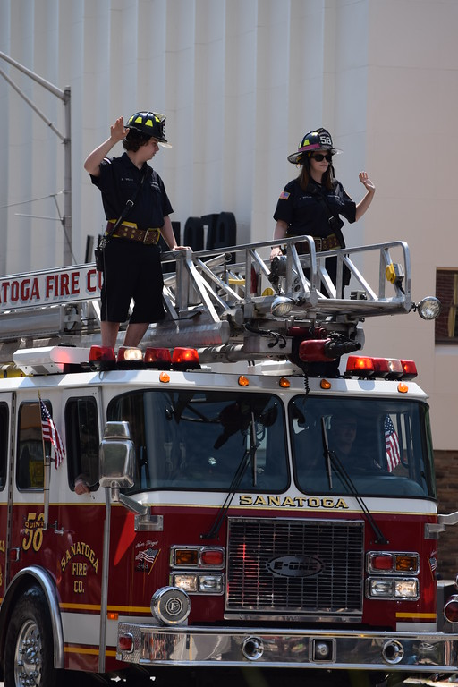 . Firefighters from area fire companies including Sanatoga waved to guests as they rode on top of the truck at the Fourth of July Parade in Pottstown on Tuesday. --Marian Dennis, Digital First Media