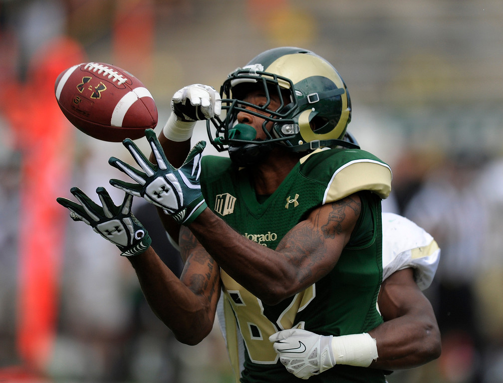 . FORT COLLINS, CO. - SEPTEMBER 14: CSU receiver Rashard Higgins hauled in a Garrett Grayson pass for a touchdown late in the second quarter. The Colorado State University football team hosted Cal Poly at Hughes Stadium in Fort Collins Saturday afternoon, September 14, 2013.  Photo By Karl Gehring/The Denver Post