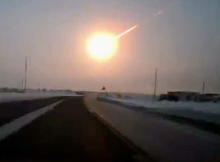. In this frame grab made from a video done with a dashboard camera, on a highway from Kostanai, Kazakhstan, to Chelyabinsk region, Russia, provided by Nasha Gazeta newspaper, on Friday, Feb. 15, 2013 a meteorite contrail is seen. A meteor streaked across the sky of Russiaís Ural Mountains on Friday morning, causing sharp explosions and reportedly injuring around 100 people, including many hurt by broken glass. (AP Photo/Nasha gazeta, www.ng.kz)