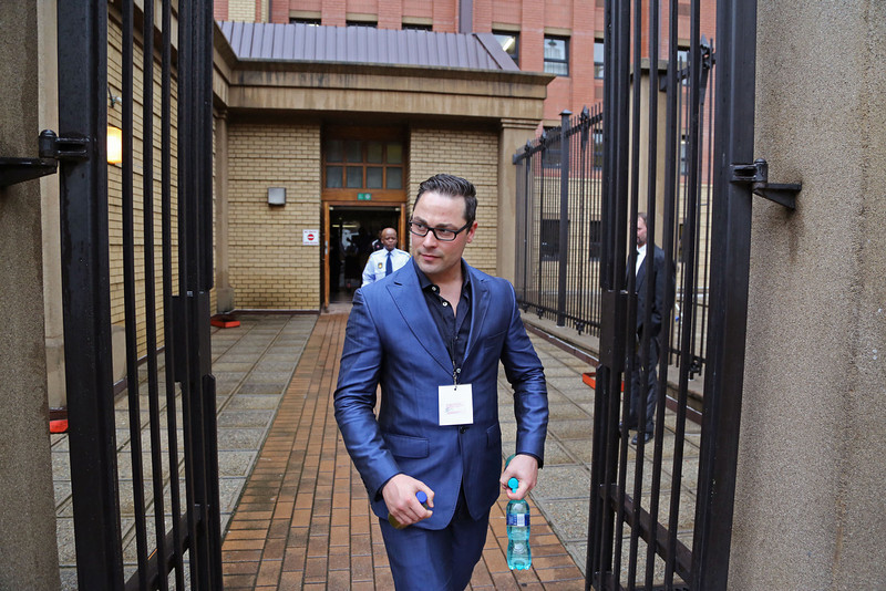 . Carl Pistorius, the brother of, Oscar Pistorius walks outside the high court before the start of his brother\'s trial in Pretoria, South Africa, Monday, March 3, 2014. Pistorius is charged with murder with premeditation in the shooting death of girlfriend Reeva Steenkamp in the pre-dawn hours of Valentine\'s Day 2013. (AP Photo/Schalk van Zuydam)