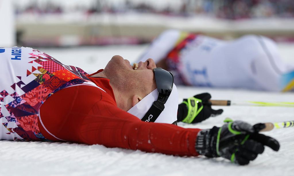 . Switzerland\'s Dario Cologna celebrates winning the men\'s cross-country 30k skiathlon at the 2014 Winter Olympics, Sunday, Feb. 9, 2014, in Krasnaya Polyana, Russia. (AP Photo/Gregorio Borgia)