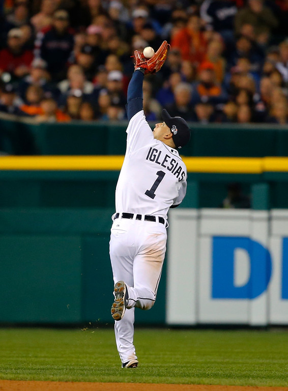 . Detroit Tigers shortstop Jose Iglesias makes a catch on a ball hit by Boston Red Sox\'s Shane Victorino in the fifth inning during Game 4 of the American League baseball championship series Wednesday, Oct. 16, 2013, in Detroit. (AP Photo/Paul Sancya)
