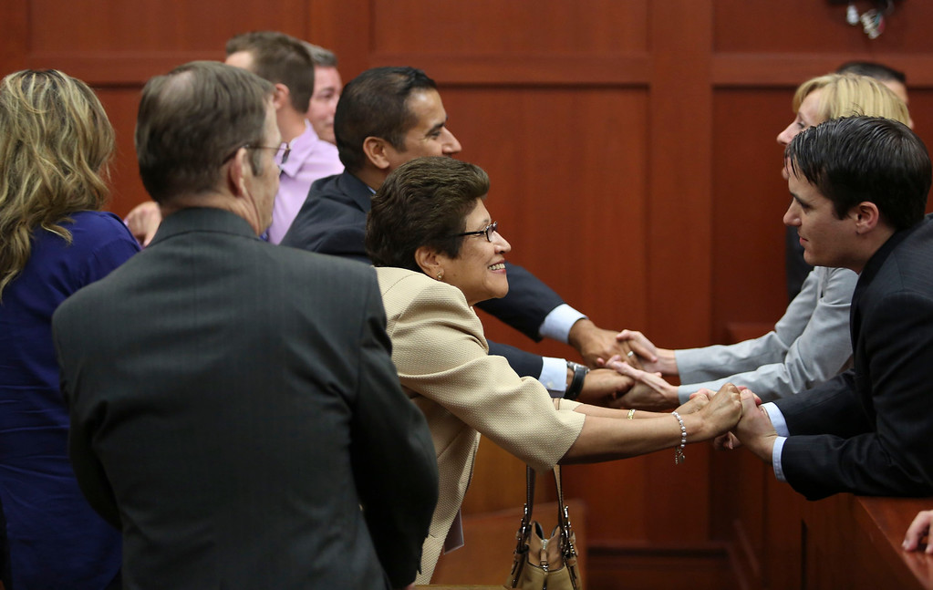 . George Zimmerman\'s family celebrates with their legal team after the jury found him not guilty in the 2012 shooting death of Trayvon Martin at the Seminole County Criminal Justice Center in Sanford, Florida, July 13, 2013. Zimmerman was acquitted of all charges on Saturday for the fatal shooting of unarmed black teenager Trayvon Martin in this central Florida town in February of last year.  REUTERS/Gary W. Green/Pool