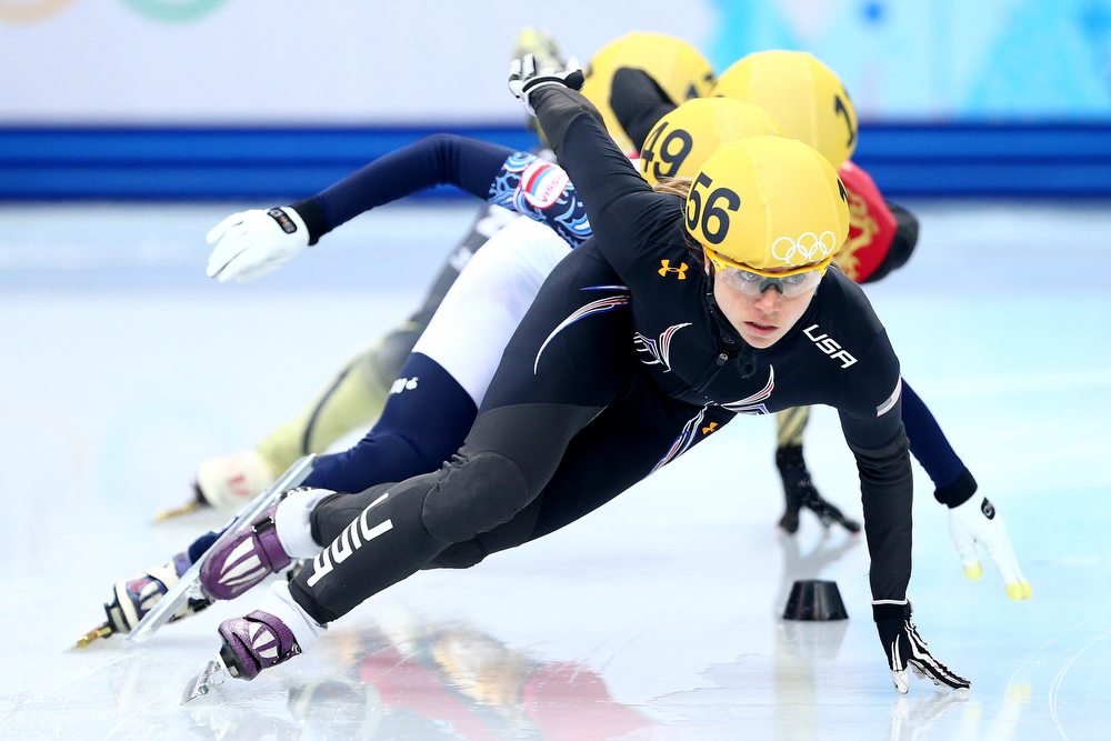 . Jessica Smith of the United States leads the pack in the Short Track Ladies\' 1000m Heat at Iceberg Skating Palace on day 11 of the 2014 Sochi Winter Olympics on February 18, 2014 in Sochi, Russia.  (Photo by Paul Gilham/Getty Images)