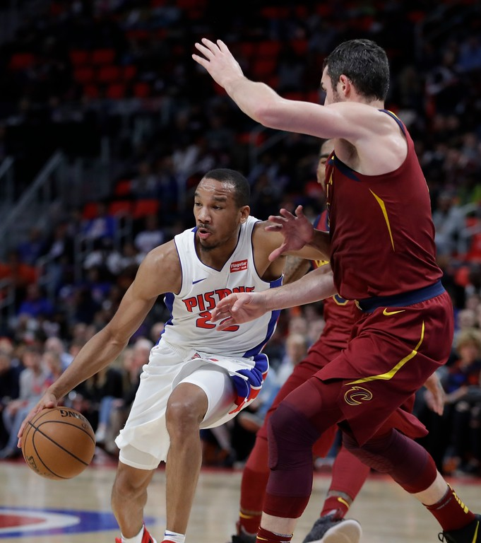 . Detroit Pistons guard Avery Bradley (22) drives around Cleveland Cavaliers forward Kevin Love (0) during the first half of an NBA basketball game, Monday, Nov. 20, 2017, in Detroit. (AP Photo/Carlos Osorio)