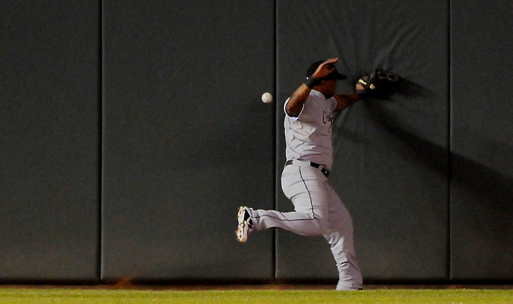 . White Sox left fielder Dayan Viciedo can\'t catch a ball hit by the Twins\' Wilkin Ramirez.  (Pioneer Press: John Autey)