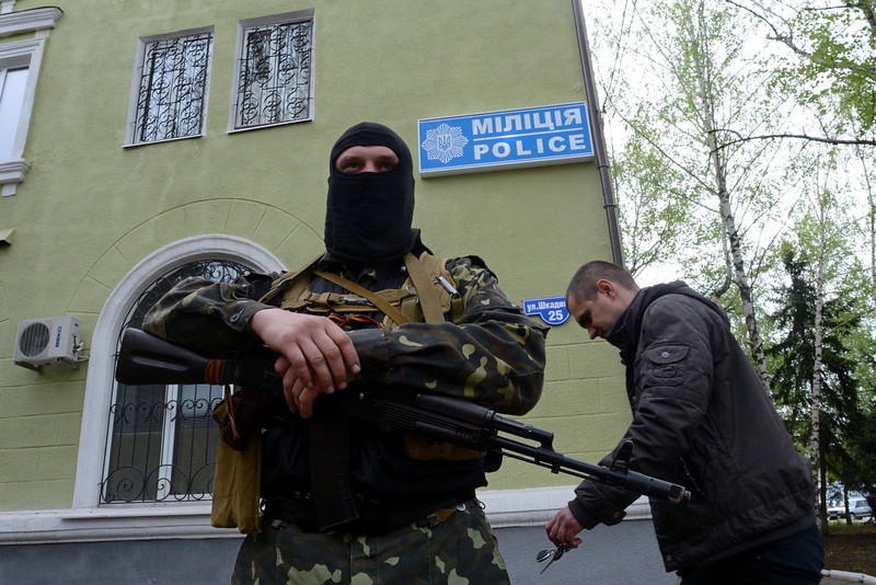 . An armed man in military fatigues stands guard outside the police regional building seized by the separatists in the eastern Ukrainian city of Kramatorsk on April 22, 2014. US Vice President Joe Biden met Ukraine\'s new pro-Western leaders Tuesday to offer firm American backing as Washington and Moscow traded blame over an unravelling peace deal to defuse the country\'s deep crisis. Under the deal signed by Ukraine, Russia, the United States and the European Union last week, pro-Kremlin rebels holding a string of eastern towns were supposed to disarm and give up the state buildings they have seized. (KIRILL KUDRYAVTSEV/AFP/Getty Images)