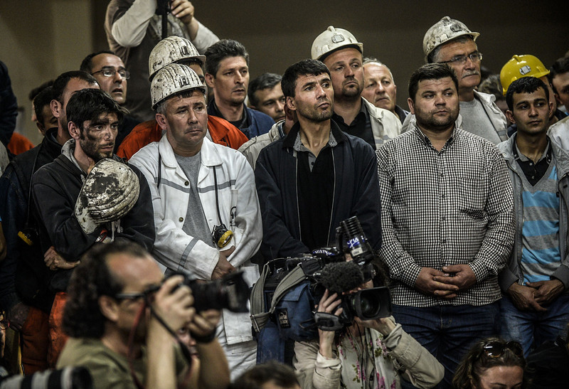 . Miners listen on May 16, 2014 during a press conference, to the Soma Holding owner, the operator of their mine where an explosion killed at least 284 workers two days before. The operator of the mine denied charges of negligence, as the government warning that the toll from the blast would likely top 300, Turkey\'s prime minister faced fresh criticism after video emerged of him apparently shouting an anti-Israel slur at angry protesters during a visit the day after to the disaster site. (BULENT KILIC/AFP/Getty Images)