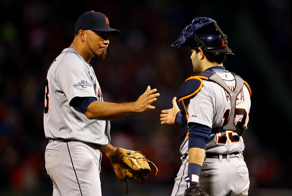 . BOSTON, MA - OCTOBER 12: Joaquin Benoit #53 and Alex Avila #13 of the Detroit Tigers celebrate after defeating the Boston Red Sox 1-0 in Game One of the American League Championship Series at Fenway Park on October 12, 2013 in Boston, Massachusetts.  (Photo by Al Bello/Getty Images)