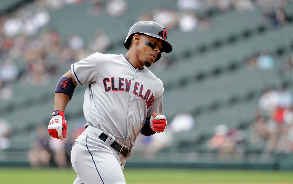 . Cleveland Indians\' Francisco Lindor heads for home after hitting a home run off Chicago White Sox starting pitcher Carlos Rodon during the first inning of a baseball game Thursday, June 14, 2018, in Chicago. (AP Photo/Charles Rex Arbogast)