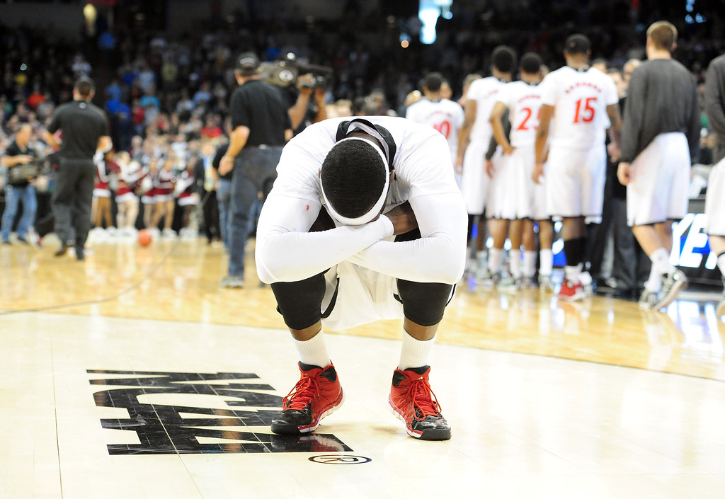 . Justin Jackson #5 of the Cincinnati Bearcats reacts after Harvard Crimson beat them in their second round of the 2014 NCAA Men\'s Basketball Tournament at Spokane Veterans Memorial Arena on March 20, 2014 in Spokane, Washington.  (Photo by Steve Dykes/Getty Images)