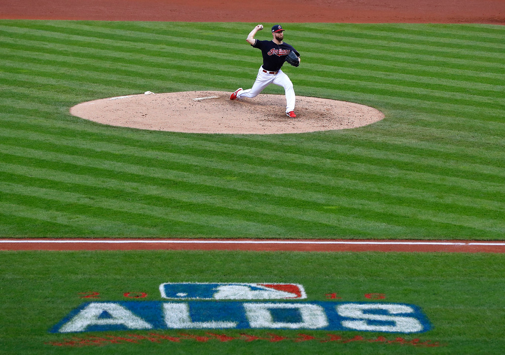 . Cleveland Indians pitcher Corey Kluber throws against the Boston Red Sox during the fifth inning of Game 2 of a baseball American League Division Series, Friday, Oct. 7, 2016, in Cleveland. (AP Photo/Paul Sancya)