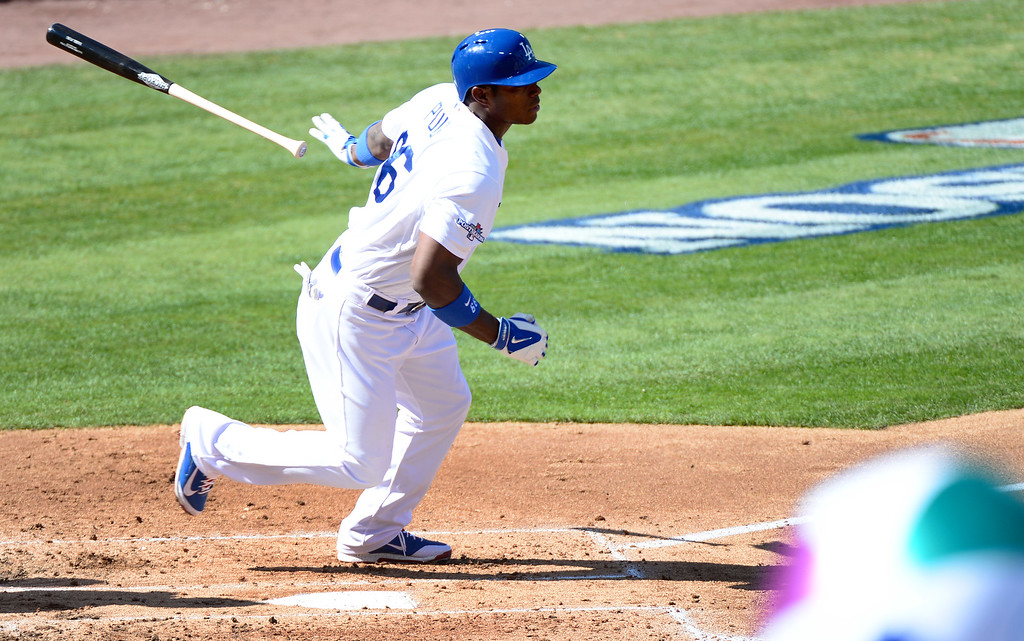 . Los Angeles Dodgers\' Yasiel Puig hits a single in the second of game 5 of the NLCS at Dodger Stadium Wednesday, October 16, 2013. (Photo by Sarah Reingewirtz/Los Angeles Daily News)