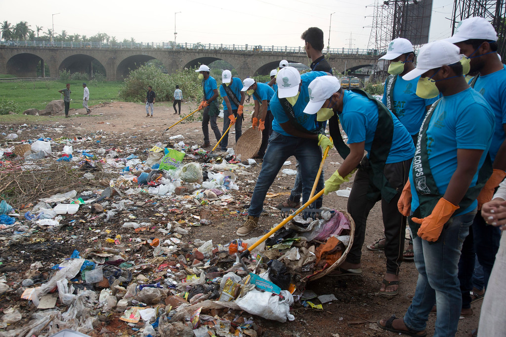 ". Members of National Green Corps clean up plastic garbage along the Musi river in Hyderabad, India, Sunday, June 3, 2018. India is the global host for the forthcoming environmental day celebrations on June 5, 2018, with a theme ""Beat Plastic Pollution\"" and launched an awareness program on environmental protection. (AP Photo/Mahesh Kumar A.)"