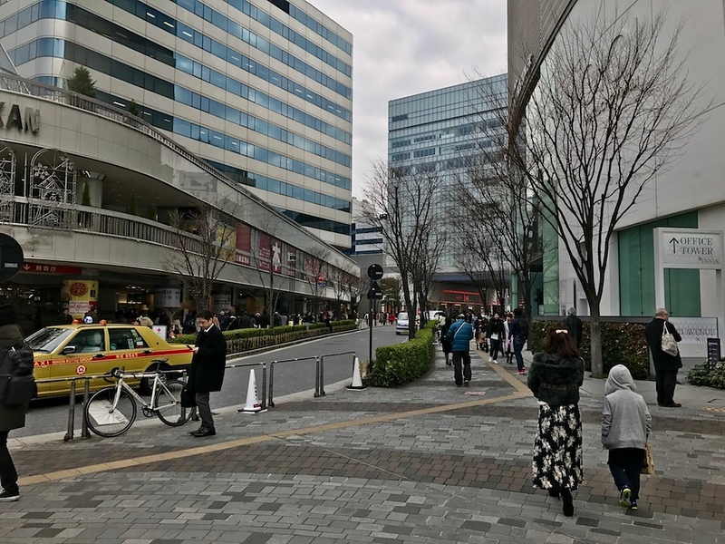 The red signage in the distance is Ginza Inz.