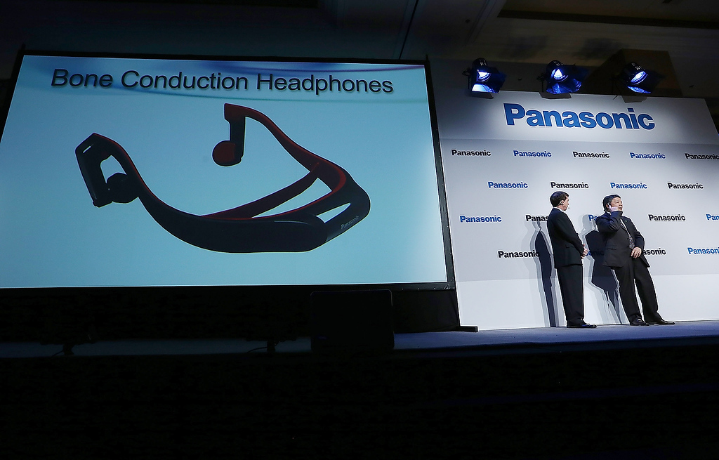 . Shiro Kitajima (R), President of Panasonic Consumer Marketing Company of North America, demonstrates Bone Conduction Headphones at a Panasonic press conference during the 2013 International CES at the Mandalay Bay Convention Center on January 7, 2013 in Las Vegas, Nevada. (Photo by Justin Sullivan/Getty Images)
