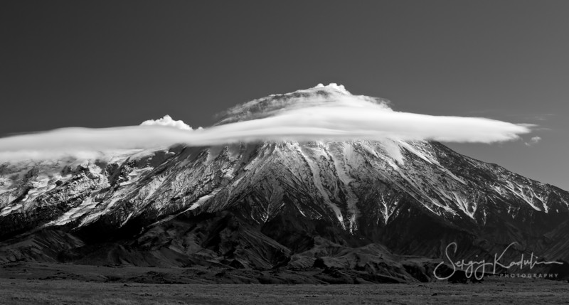 Tolbachik volcano covered with lenticular clouds